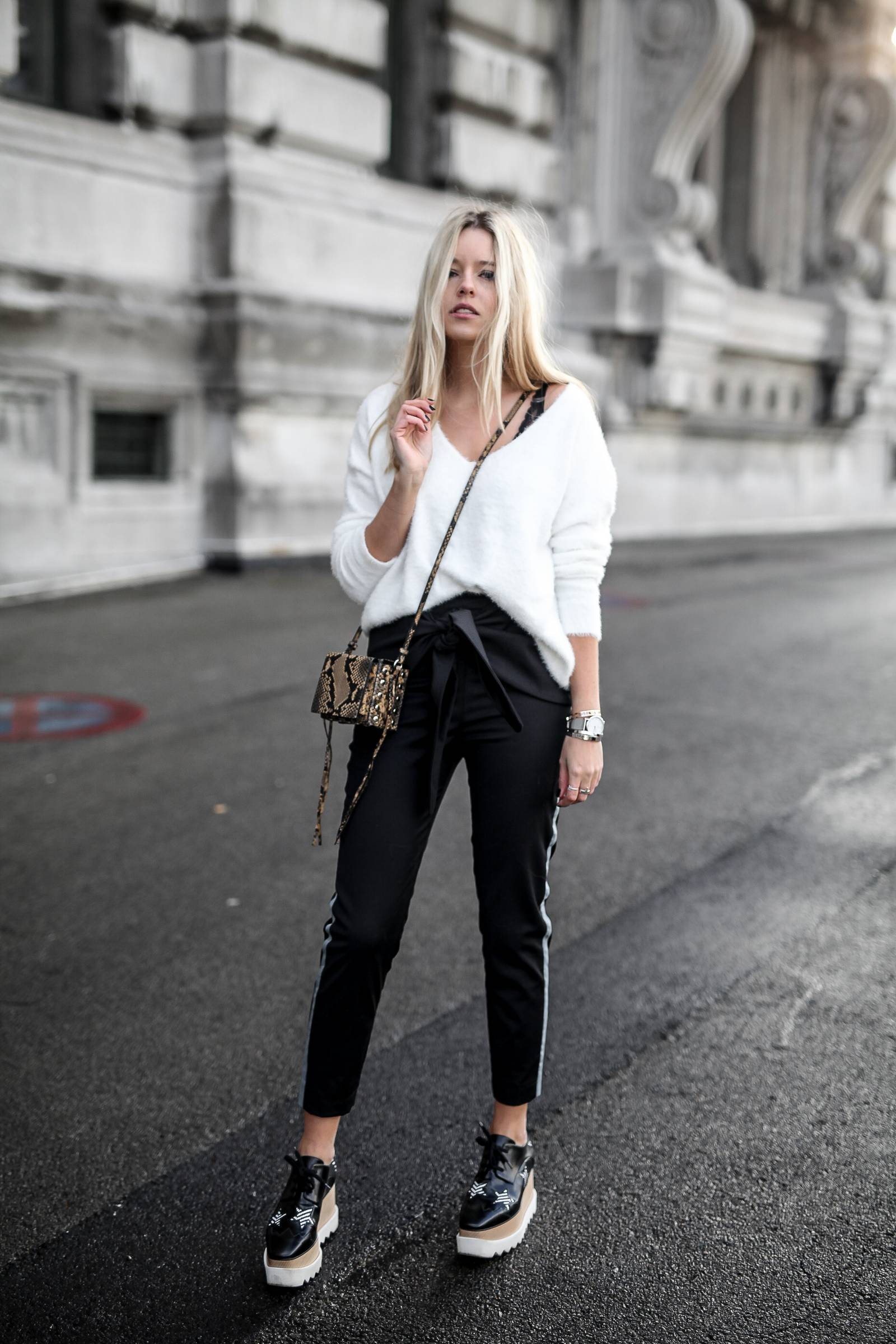White knit, chino pants, and elyse stella mccartney shoes