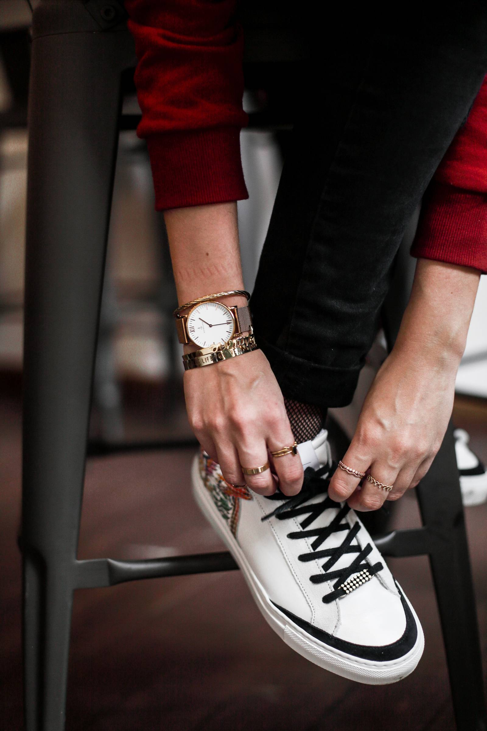 tropical sneakers and gold jewels