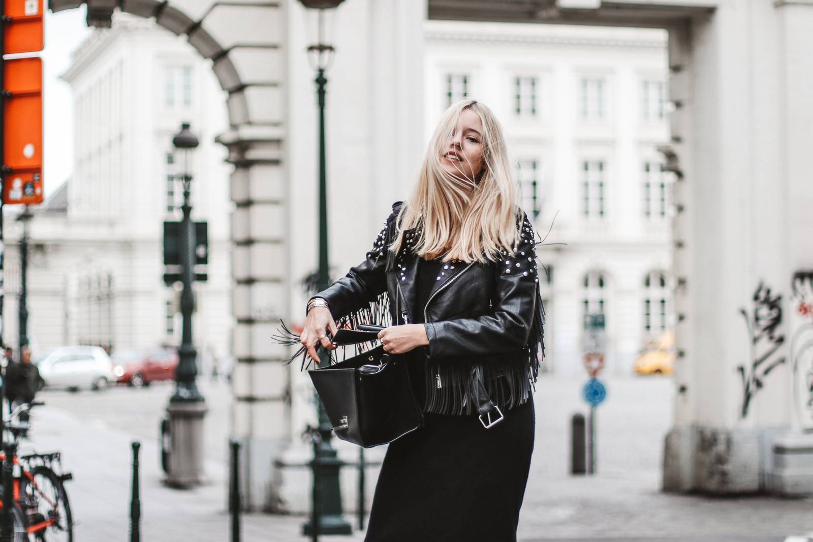 Fringed jacket, fishnet tights and Céline trapeze bag