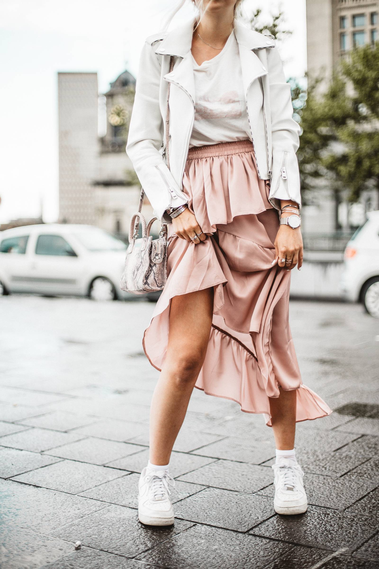 Asymetric skirt and white leather jacket